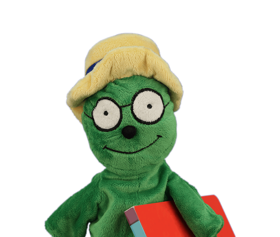 green puppet holding a book