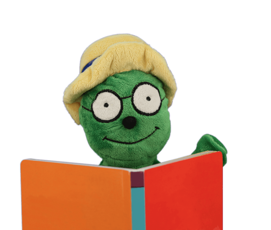 green puppet reading a book