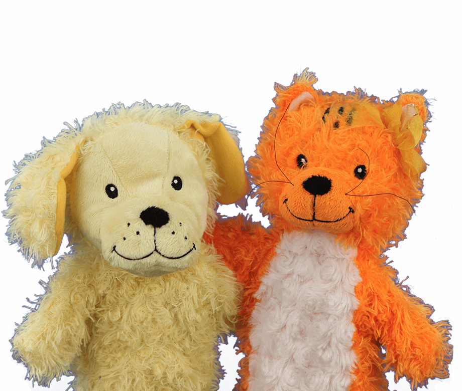 Primrose puppets Katie the cat and Erwin the dog with their arms around each other.
